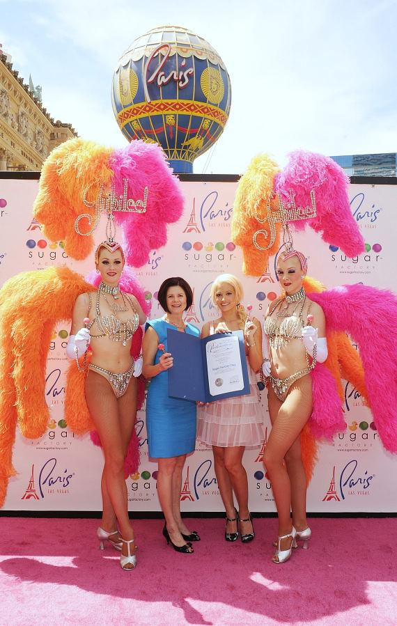 "Holly Madison with Jubilee showgirls and ""Sugar Factory Day"" plaque"