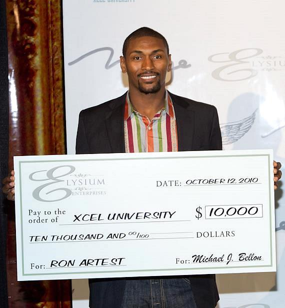 Ron Artest with donation check for Xcel University from developer Michael J. Bellon