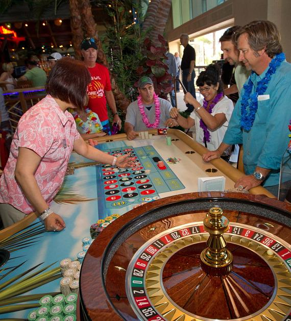 The first guests place their bets at the roulette wheel at Margaritaville Casino