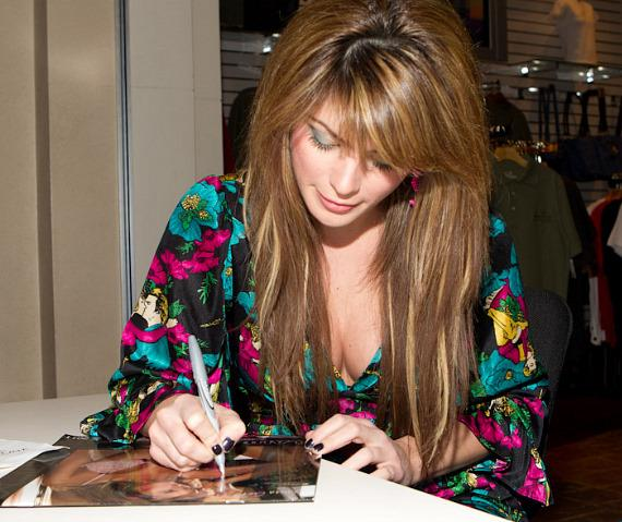 Laura Croft signs her 2011 Calendar at Mandalay Bay