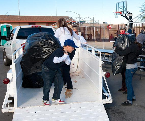 Blaze Trumble helps unload donations at The Las Vegas Rescue Mission