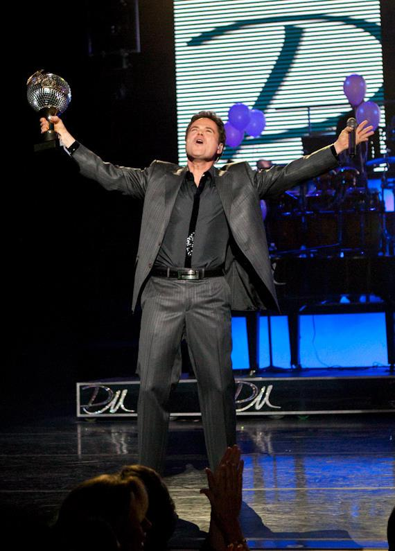 Donny brings his trophy on stage during the Donny and Marie show at The Flamingo