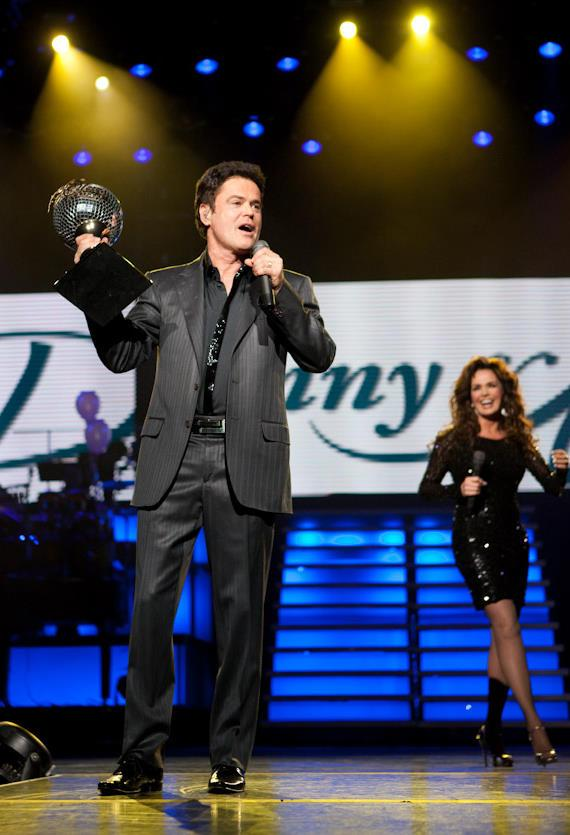 Donny shows the audience his Dancing With The Stars trophy
