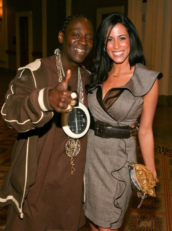 Flavor Flav poses with the Obama Girl