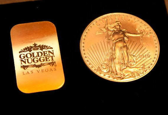 10 gram Golden Nugget Souvenir Bar and a 1 Ounce American Eagle Coin