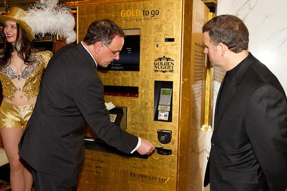 Thomas Geissler and Tilman Fertitta make first gold purchase from GOLD to Go ATM