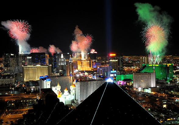 Fireworks burst over the Las Vegas Strip at midnight on New Year