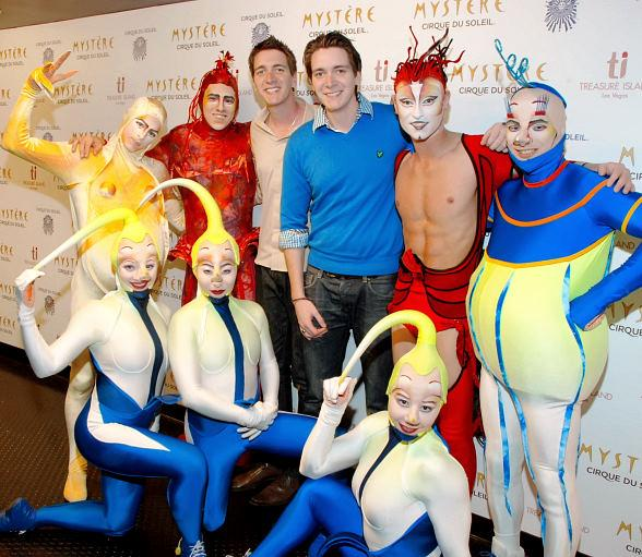 James and Oliver Phelps with the cast of Mystère by Cirque du Soleil at Treasure Island Las Vegas