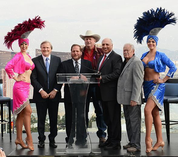Las Vegas Showgirls join community leaders and organizers to usher in plans for America's Party 2014. From left are Pat Christenson, president of Las Vegas Events; Andy Kaye, KOMP Morning Show host and emcee; Tom Collins, LVCVA chairman and Clark County Commissioner; Mayor Pro Tem Stavros Anthony; and Philip Butler, Fireworks by Grucci.