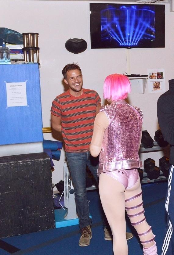 Brandon Flowers chats with a dancer backstage at Michael Jackson ONE by Cirque du Soleil at Mandalay Bay Resort and Casino