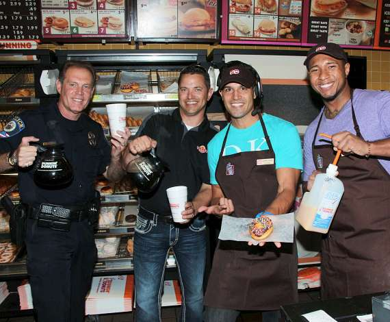Officers from Clark County School District Police Department with BMX Pro Ricardo Laguna at Dunkin' Donuts benefit for Nevada Childhood Cancer Foundation