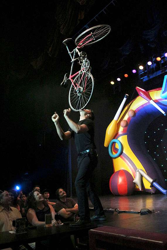 Jeff Civillico balances a bicycle on his chin