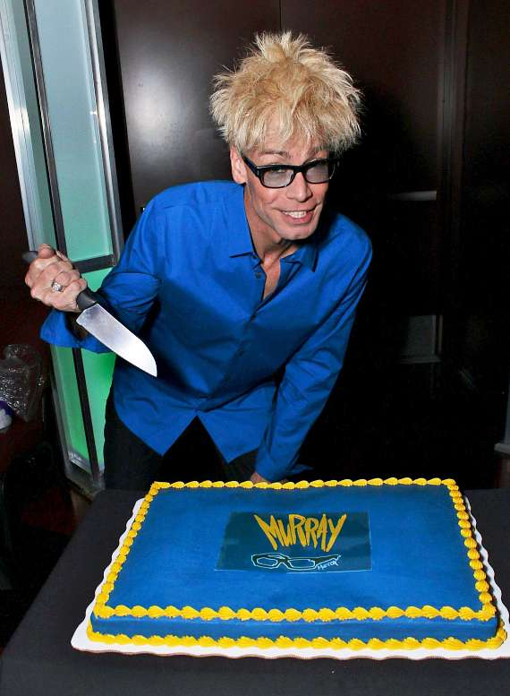 Murray cuts the welcome cake in the Sin City Theatre in Planet Hollywood Las Vegas
