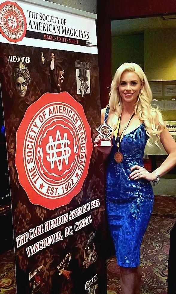 "Chloe Crawford receives ""Assistant of the Year Award"" from Society of American Magicians"