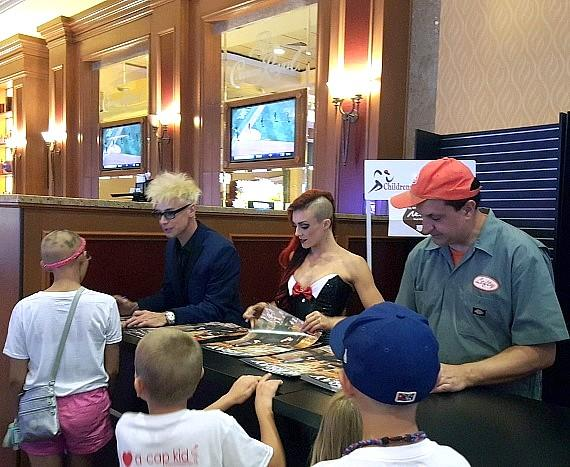 "Murray SawChuck, April Leopardi Anneberg and Douglas ""Lefty"" Leferovich sign autographs at South Point Hotel Casino"