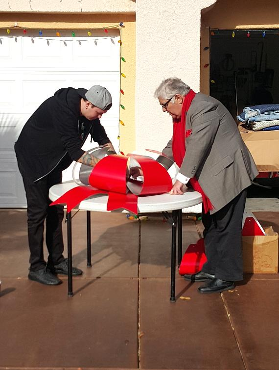 "Douglas ""Lefty"" Leferovich and Lenny Windsor work on decorations"