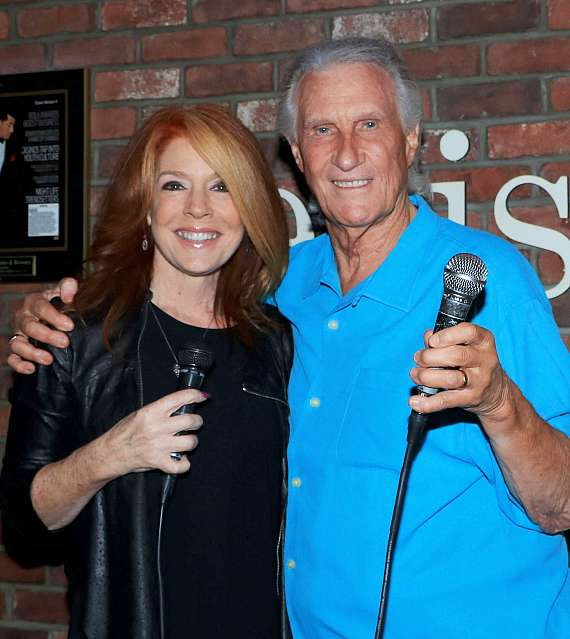 "Kelly Clinton-Holmes and Bill Medley at Ellis Island's ""Sing for Strength"""