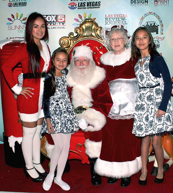 Model/Dancer Dixie Miranda with her daughters and Santa & Mrs. Claus
