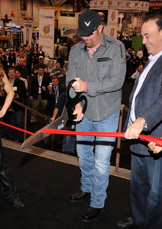 Toby Keith and Jon Taffer at ribbon cutting for 27th Annual Nightclub & Bar Convention