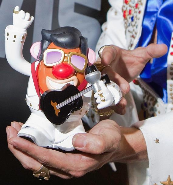 Hasbro licensee, PPW Toys, suits up MR. POTATO HEAD as Elvis Presley for a unique co-branded product. An Elvis tribute artist shows off the new collectible during a launch event at Licensing International Expo 2010 in Las Vegas.