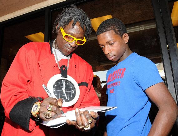 """Flavor Flav signs autographs at """"House Of Flavor"""" BBQ Restaurant"""