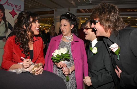 Marie gets a surprise as John Titta, his wife Lana, and Richie Sambora visit the doll signing
