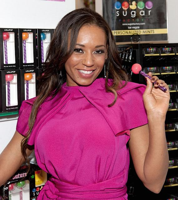 Mel B poses with her new signature line of Couture Pops at Sugar Factory