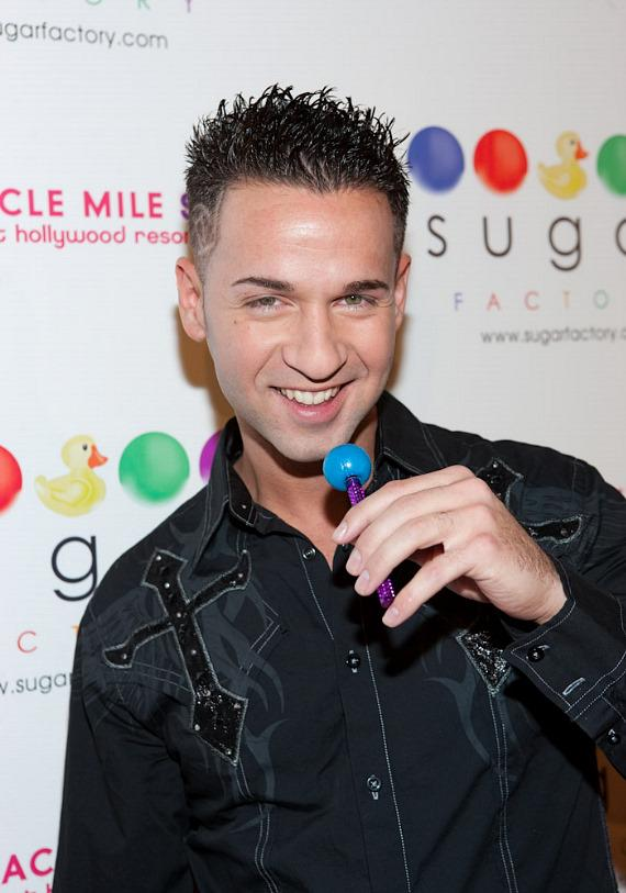 "Mike ""The Situation"" Sorrentino on the red carpet at Sugar Factory with a Couture Pop"