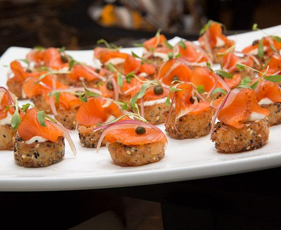 "Guests sample ""Bagel and Lox"" off of Chef Nobu's debut in-room dining menu"