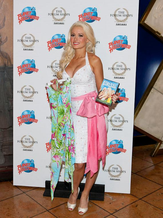 Holly Madison with a dress and DVD being donated to Planet Hollywood