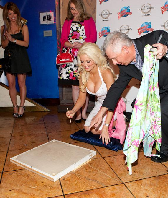 Holly Madison is about to sign her name in the cement at Planet Hollywood