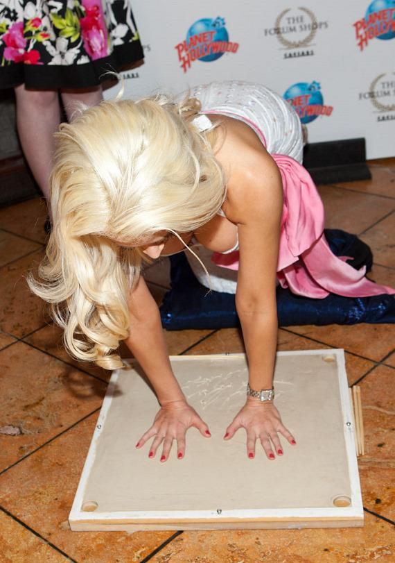 Holly Madison presses her hands into the cement at Planet Hollywood