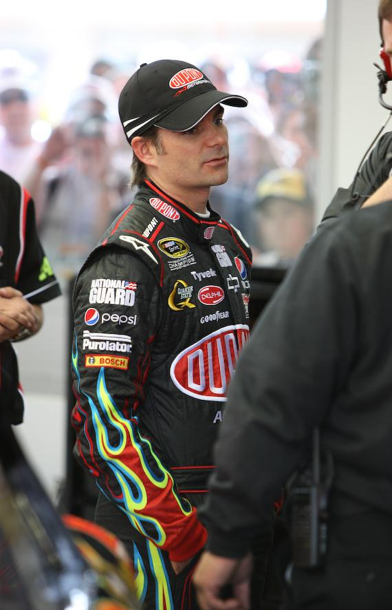 Jeff Gordon talks with team members