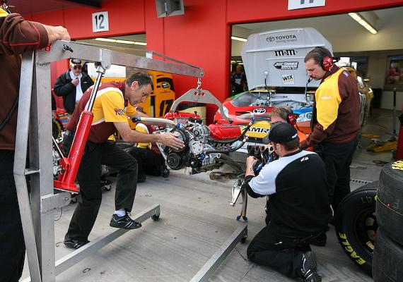 Kyle Busch team installs a new engine into his car just before qualifying