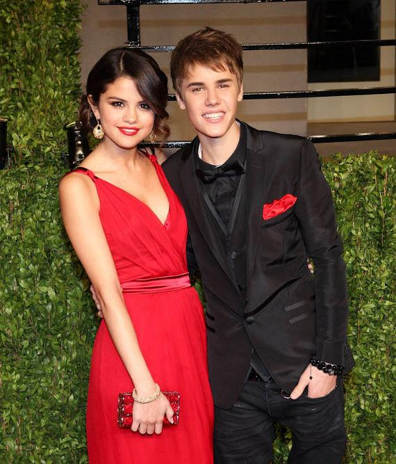 Selena Gomez and Justin Bieber arrive arm in arm at The Vanity Fair Oscar Party in Los Angeles