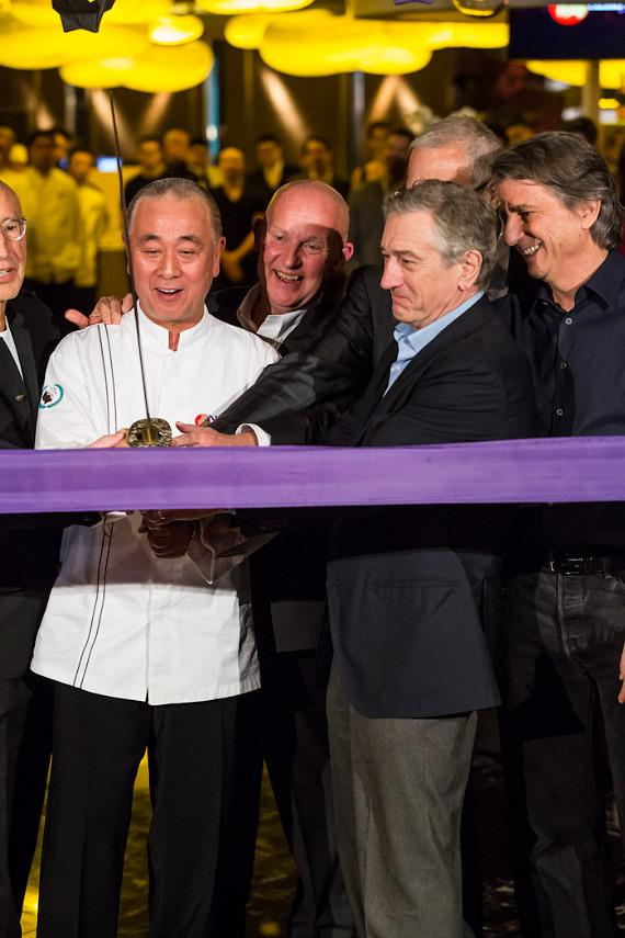 Chef Nobu Matsuhisa and Robert DeNiro prepare to cut the ribbon