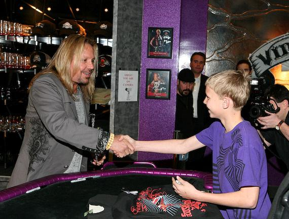 Vince Neil greets a young fan