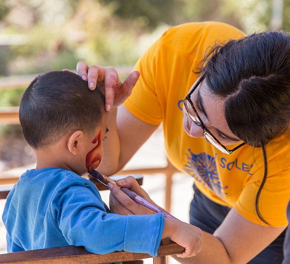 Guests enjoy complimentary face-painting at Run Away with Cirque du Soleil