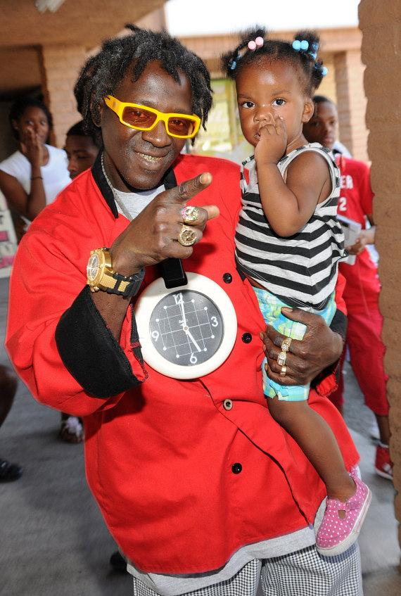 """Flavor Flav with fan at """"House Of Flavor"""" BBQ Restaurant"""