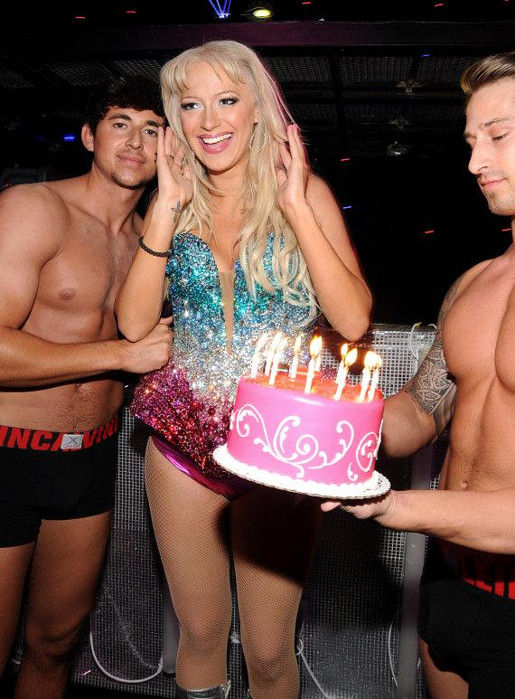 Former Pussycat Doll Kaya Jones gets a birthday cake from Krave dancer