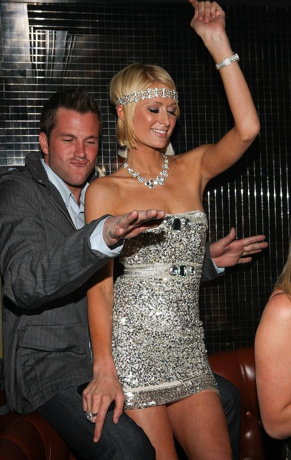 Paris Hilton and Doug Reinhardt dance in their private booth at Body English at Hard Rock Hotel & Casino