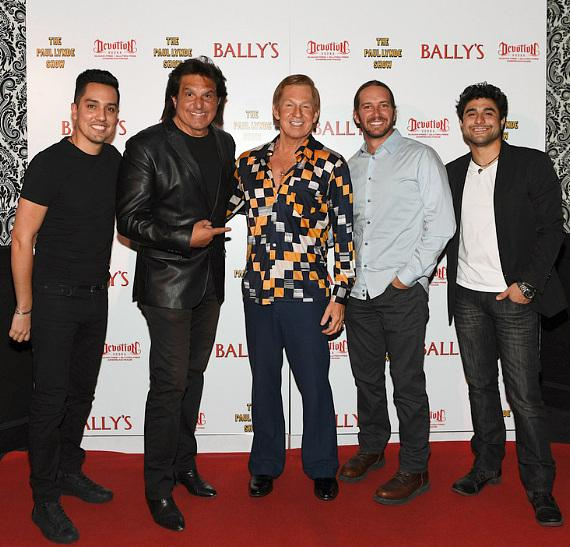 Michael Airington, star of The Paul Lynde Show, poses on the red carpet with The Bronx Wanderers at the grand opening of his show at Bally's Las Vegas