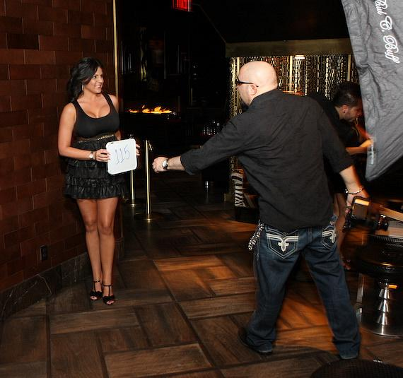 Joe Fury photographs a Playboy Model contestant