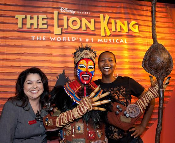 Attraction Manager for Madame Tussauds Rosita Chapman with wax figure of Rafiki and actress Buyi Zama