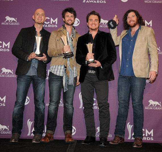 Jon Jones, Chris Thompson, Mike Eli and James Young of the Eli Young band with Song of the Year award