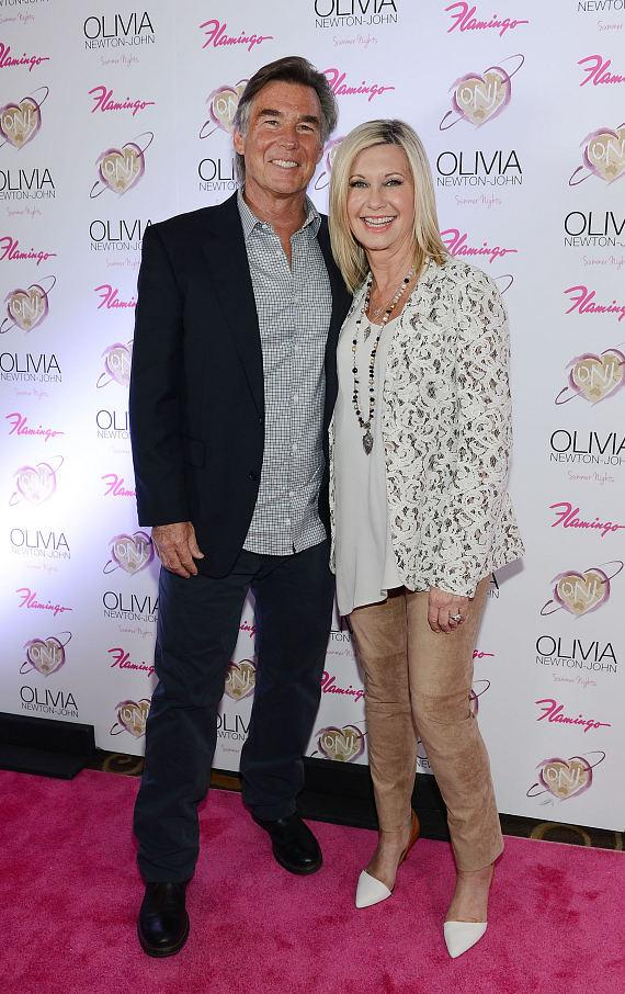 "Olivia Newton-John and husband John Easterling at opening of ""Summer Nights"" at The Flamingo in Las Vegas"