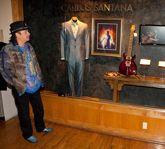 Carlos Santana looks at the case