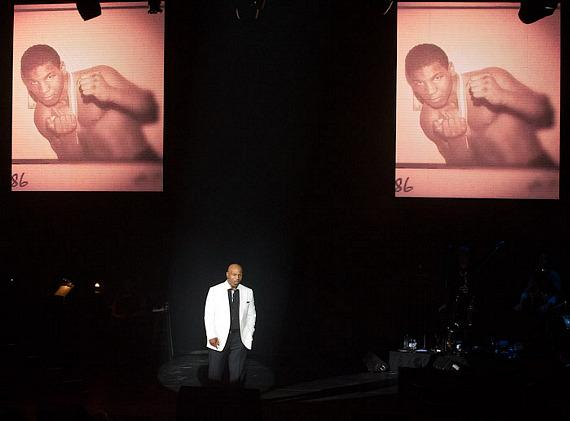 """Mike Tyson with early photos of himself in his """"Undisputed Truth"""" show in Las Vegas"""