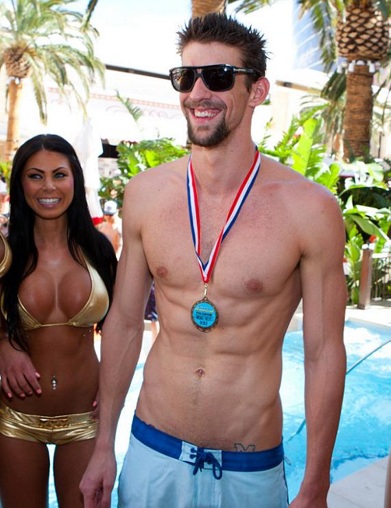 Michael Phelps with Susan Holmes Swimwear Gold Bikini model