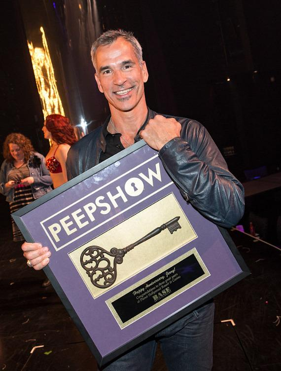 Tony Award winning director/choreographer Jerry Mitchell with a personalized antique key and plaque to commemorate three wonderful years of success on the Strip